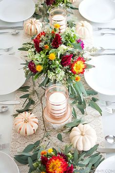 Fall might be associated with dark, warm tones, but shiny elements will make your Thanksgiving table glimmer. Amy Kim of Homey Oh My! added gold accents to her centerpiece for extra glitz.