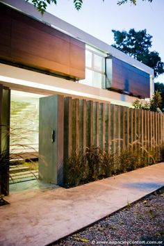 these 27 fence ideas provide security and privacy while adding beauty to any modern house. Contemporary Architecture, Architecture Details, Interior Architecture, Interior And Exterior, Boundary Walls, Rustic Stone, Modern Fence, Model Homes, Facade