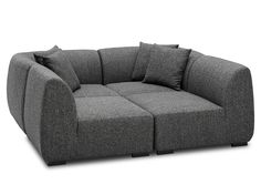 Cool take on a sectional, makes me want to curl up and spend a week watching movies!