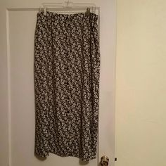 Ladies long skirt 100% polyester ladies skirt.  Taupe floral on a black background.   Buttons down the front. Kathi Lee Skirts Midi