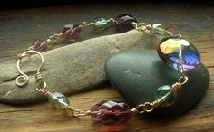 Iridescent Translucent glass bead Nu Gold wire by kmaylward