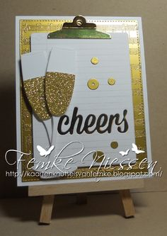 made by femke niessen: cheers. I used gold embossingpowder on gold metallic cardstock (love that). MFT dienamics: blueprints 13, office supplies, sequins, champagne glass. background is MFT too.