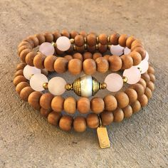 Rose quartz for Love, and Aromatic Sandalwood for Healing, with a Tibetan pearl guru bead, mala bracelet or necklace. #malas