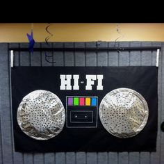 Boom Box Decoration for music or hip hop themed parties. Speakers made from hula hoops and aluminum foil.