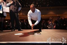 Geroy Simon (BC Lions) rocking some on stage push ups at the Red Robinson Show Theatre for the SHARE Imagine Gala.