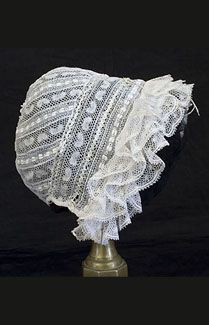 """Valenciennes lace baby bonnet c. 1850  """"Valenciennes lace is best cleaned if folded in regular lengths, sewed in a bag of fine linen, and soaked in olive oil for ten hours. After this the sack should be boiled in pure white soap suds for fifteen minutes.  Rinse well in rice water and iron under muslin"""" from The Care of Lace, 1910."""