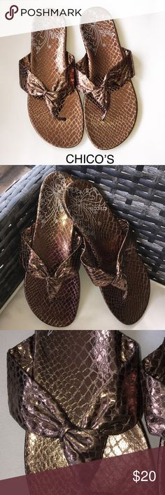 Flip Flops By Chico's (SOLE METAL) EUC SIZE 9 These flip flops are so pretty. They are a bronze color with hints of gold. My flash is picking up some different colors that don't exist 😘 only worn once on vacation. Really cute and very clean💕💕💕 Chico's Shoes Sandals
