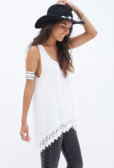 """Your inner boho goddess will fall in love with this ethereal sleeveless tunic. It features a beautiful crochet pattern along the hem, followed by a crochet lace triangle insert on the back. Its lightweight, sheer material and scoop neck make it a perfect summertime piece, especially when paired with braided sandals and your go-to sunnies. Unlined Woven Shell 1: 100% rayon; Shell 2: 100% polyester 32.5"""" full length, 37"""" chest, 41"""" waist Measured from Small Hand wash cold Imported"""