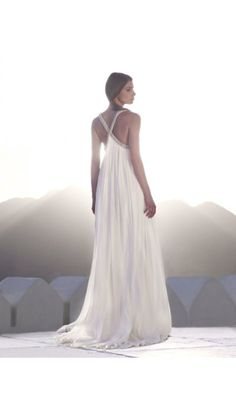 The bride wears a silk georgette halterneck wedding dress with Cleopatra beading detail. AW108 Amanda Wakeley