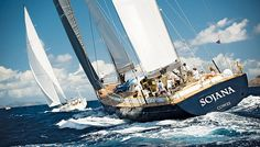 Skipper Peter Holmberg sprung catlike between the twin helms of Sojana, his boat shoes squeaking on the sailing yacht's deck as