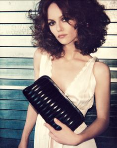 Vanessa Paradis with layered long curly bob.