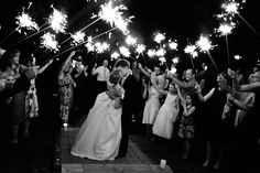"""Liz and Jordan - We loved the awesome pictures we got with the sparklers and they created a """"send-off to remember""""! We loved that the sparklers were affordable as well.  Sparklers were definitely a great way to end an amazing night. - Studio 19 Photography"""