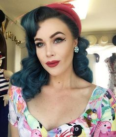 pinup babe with blue hair and red lipstick suavecita pomade
