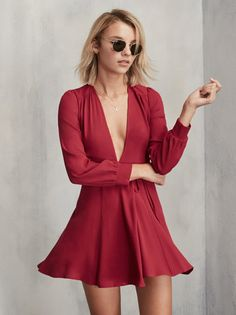This is part of the Don't Call Me Cute Petites Collection - specially designed for ladies 5'4 and under.  Just a little something for your twirls. The Petites Leslie Dress is a wrap fit and flare mini dress with a plunging neckline, long sleeves and an adjustable tie at the waist. https://www.thereformation.com/products/petites-leslie-dress-cherry-bomb?utm_source=pinterest&utm_medium=organic&utm_campaign=PinterestOwnedPins