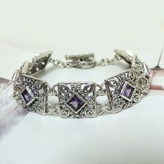 Would look great stacked with my watch! Sterling Silver Amethyst Square Link Toggle Bracelet
