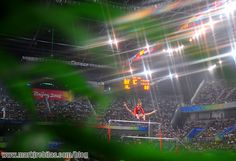 """The photographer knew exactly what he was doing here--with the different layers to show the depth of field, adding the star filter...Nastia Liukin on bars makes it beautiful as well.  I especially love the """"Beijing 2008"""" perfectly framed on the left."""