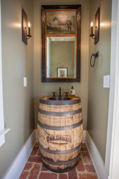 Jack Daniels Whiskey barrel sink in this Alabama ranch bathroom