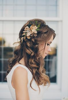 Long, Curly Hair with Gold-Hued Flowers   I absolutely adore this...wish I could see back, wouldn't want too much volume but I do like how the flower is incorporated so it doesn't look too summery or beachy