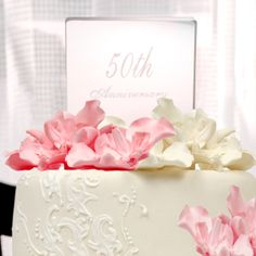 Personally Engraved Gifts  - 50th Wedding Anniversary Acrylic Cake Topper, $22.50 (http://www.giftthings.net/50th-wedding-anniversary-acrylic-cake-topper/)