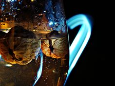"#light painting #nuts   nuts make an ""bloom"" into water "":)"