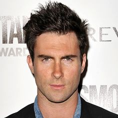 ADAM LEVINE - 2009 Mussed locks and a deep tan in Los Angeles.