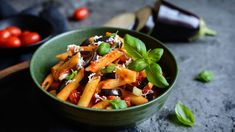 pasta alla norma - traditional italian food with eggplant tomato cheese and basil Penne, Pasta, Omelette Legume, Tomato And Cheese, Potato Salad, Ricotta, Fruit Salad, Eggplant, Italian Recipes