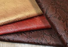 This collection can take you back into the jungle giving you the look of a real Cascavel without hurting Mother Nature.  #embossedleather #customembossedleather #customcolorleather #leathertiles #upholsteryleather http://barbarossaleather.com