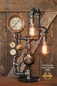 Furnishing This lamp is something you would find in a steampunk home. Incandescent light bulbs are are very industrial looking, adding a gadget/mechanical look. Steampunk House, Steampunk Lamp, Modern Industrial Decor, Industrial Lighting, Rustic Coat Rack, Antique Iron, Antique Brass, Rustic Lighting, Rustic Chandelier
