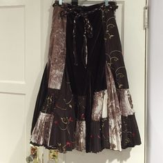 Brown Skirt Brown skirt with a braided belt included, zipper in the back, has flower designs throughout dress, and sequences Magnet Skirts