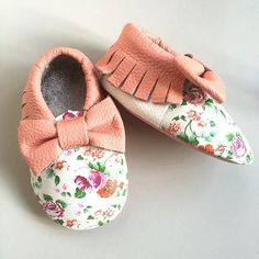 Unique genuine leather floral pink peach fringe moccasins are one of a kind with a detailed flower designs and pink bow on the front. These are made with real leather and will make your baby look fashion forward with these trendy shoes.     Size:  0-6 Months = 4.7 inches a typical size 1  6-12 Months = 5 inches a typical size 2  12-18 Months = 5.3 inches a typical size 3  18-24 Months= 5.90 inches a typical size 4