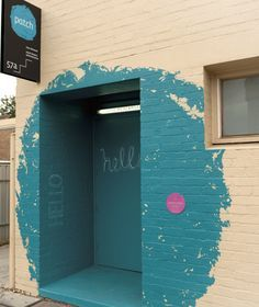 entrance way for Patch Theatre company. The blue dot logo is made gigantic, and patrons walk through it.