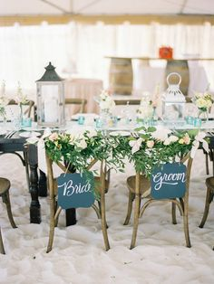beach wedding sweetheart table - photo by Lauren Kinsey http://ruffledblog.com/sophisticated-beach-wedding-at-edgewater-resort
