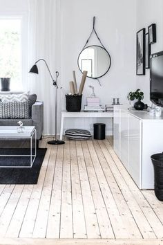 clean lines, white walls, neutral color palette and wood