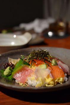 Japanese Food Chirashizush (Unrolled Sushi) - Tuna, Salmon, Ikura Caviar... Fresh Sashimi and Shredded Egg Crepe over Sushi Rice