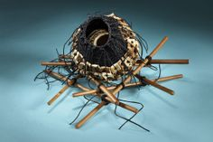 CARGO: woven and stitched vessel with enclosed vessel inside on peeled willow frame. Artist: Shannon Weber, Oregon