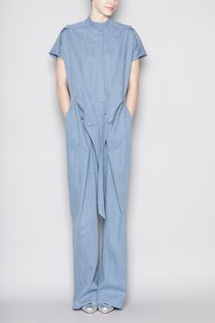 Short sleeve jumpsuit in a medium-weight denim fabric. Round neck with concealed front button closure. Elastic back waist with attached belt tie. Seam flat at shoulders. Side slit and rear pouch pockets. 50 Fashion, Fashion Books, Hijab Fashion, Western Outfits Women, Denim Fabric, Comfortable Fashion, Pattern Fashion, Casual Outfits, Christian Wijnants