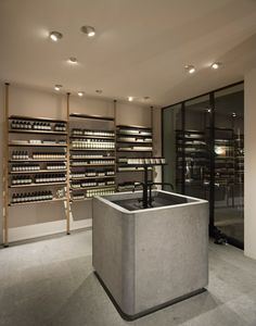 Vincent Van Duysen Architects fits Aesop's Hamburg store with a chunky stone sink.