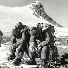 Charles Evans and Tom Bourdillon try to gather their strength upon their return to Camp VIII from the South Summit. Problems with Evans' oxygen equipment and a lack of time had prevented them from making an attempt on the Summit itself. During their descent from the Southeast Ridge, Evans had slipped, dragging Bourdillon with him and they had been lucky to arrest their fall. Photograph: Royal Geographical Society - 1953 British Everest expedition.
