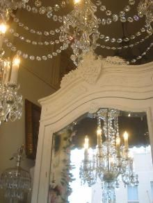 vintage glamour - I love the use of crystals, white baroque style, reflection in the mirror, and chandeliers