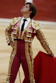 "Actual Matador Clothing | Spanish bullfighter Julian Lopez ""El Juli"" tries to get a bull's ..."
