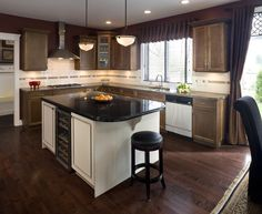 Traditional kitchen renovation that made simple updates to really transform the room. They refinished the hardwood floors, replaced the cabinet doors and added a new countertop to the large kitchen island. #granitecounters #granite #kitchen #refinishedfloors