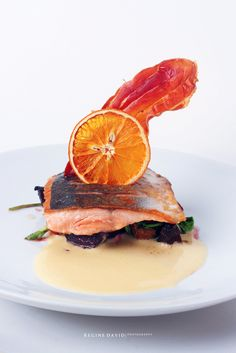 HAUTE CUISINE   chef justin david x =anti00gravity This would be the roast side of Tasmanian salmon on a bed of arugula, beetroot, and baby potato salad, with maltase sauce. This is topped with a s...