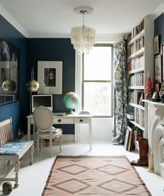 Take a modern approach and paint the walls navy blue, hang a chandelier overhead and long drapes on the windows.