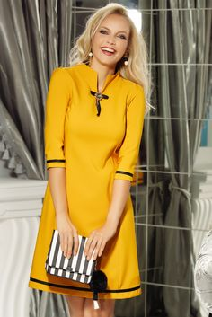 eb6578d665 Fofy mustard elegant a-line 3/4 sleeve dress accessorized with breastpin,  without clothing, 3/4 sleeves, soft fabric, slightly elastic fabric, ...