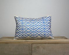 This pillow cover is made of 100% linen in natural color. Front of the cover has been screen printed by hand with my original tribal pattern.