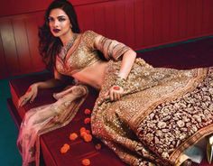 Deepika Padukone in Sabyasachi on VOGUE India. Find this gorgeous lehenga in store now! Golden Bridal Lehenga, Sabyasachi Lehenga Bridal, Indian Bridal Wear, Lehenga Choli, Lehenga Blouse, Lehenga Style, Deepika Padukone, Indian Dresses, Indian Outfits