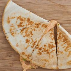 Just Like Taco Bell- Chicken Quesadillas Recipe with cream cheese, sour cream, chile powder, cumin, garlic powder, salt, ground coriander, cayenne pepper, Mexican cheese blend, chicken breasts, green chile, rotel tomatoes, flour tortillas, cooking spray