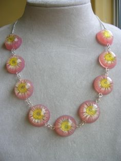 Real daisy chain preserved in resin necklace by shpangle jewellery, via Flickr