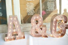 Rose gold marquee letters monogram | Photo by The Cannons Photography | Whimsical Rose Gold Wedding on…