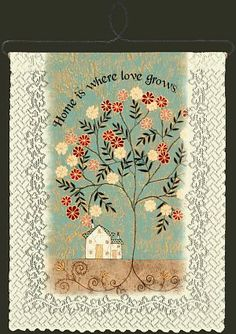 """Home is where Love grows"" wall hanging"